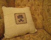 Hand Knitted, square paneling, Aran knit with embroidery applique.
