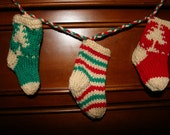 Hand knitted Christmas Stocking Garland with jingle bells.