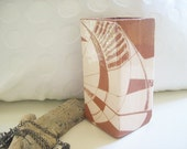 ceramic vase, square from red clay with white coating