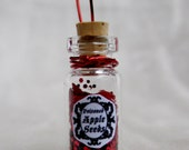 Poisoned Apple Seeds- Fairy Tale Bottle Pendant