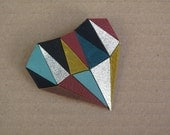 Multi-coloured geometric abstract leather brooch with gold coloured leather accents