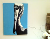 Blue pelican stencil art painting, spray painted on 18 in x 24 in gallery canvas