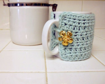 sea green coffee cozy with large vintage button.