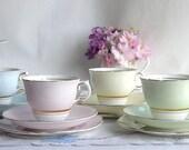 RESERVED FOR LIZ:  8 lovely pastel tea sets, Colclough bone china trios, 2 mint green, 2 pale lemon, 2 pale blue, 2 pale pink
