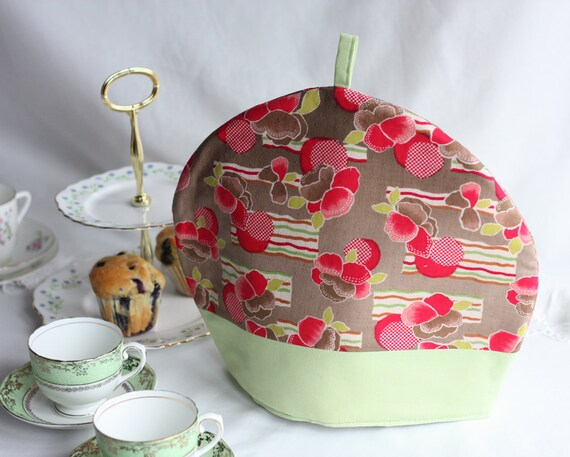 Tea cozy with vibrant Japanese patterned fabric and spring green cotton base - filled with Insulbrite and bamboo/cotton mix