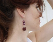 Crocheted earrings with glass beads  in brown