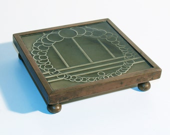 beautiful antique tile coaster from the 40's . art deco tile . massive bronze frame . patina. vintage. very british