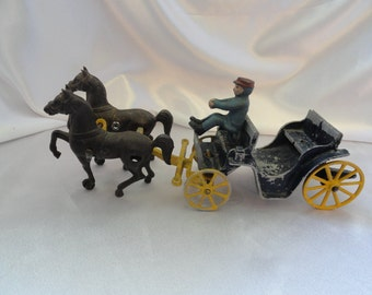 1930s cast iron carriage and two horses with driver, by Stanley toy in USA