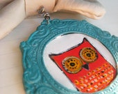 Polymer clay hand painted owl necklace with handsaw bow