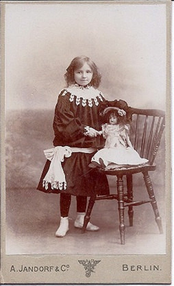 Vintage Photo - Girl Posing with Doll early 1900s Europe Sepia Real Photograph Carte de Visite CDV