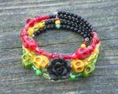 Cotton Candy Soulriginal Rasta Skull Red Yellow and Green Memory Wire Bracelet