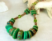 Ethnic green necklace with disc-shaped beads. OOAK