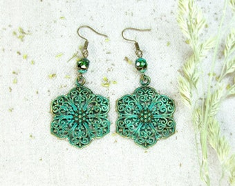 Brass flower earrings with green blue patina.