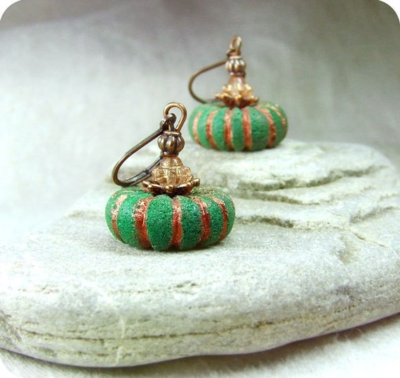 Green ethnic earrings.