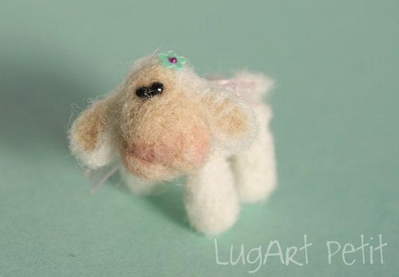 Needle felted tiny sheep.
