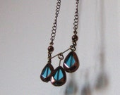 m a r g a r e t  / / long antique brass chain necklace with bronze-rimmed turquoise glass pendant