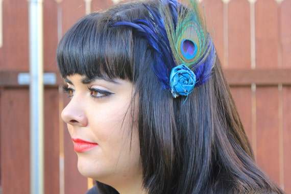 The Kenley- royal blue hackle feather with peacock feather and blue rosette