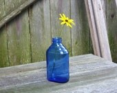 Vintage cobalt blue Hazel Atlas bottle