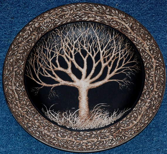 Wooden platter decorated with pyrography and paint