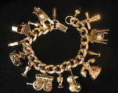 Vintage Gold tone Charm Bracelet  15 different charms