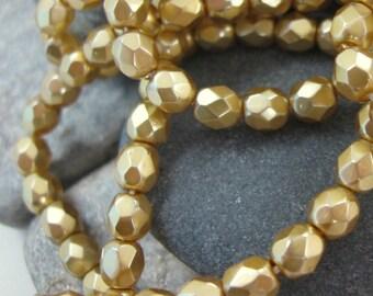 4mm Czech Facet Glass Beads in Pearl Matte Gold.  3 dz.