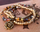 Layer Bracelet with Brown Glass Beads and Gold Rose Charm Gathering