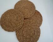 Four seventies-style raffia place mats