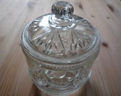 Pressed glass storage jar with Victorian-style swags design