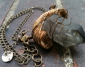 fossil ammonite and black included smoky quartz point necklace