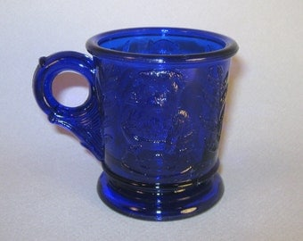 Vintage Mosser Childs Mug with Cat in a Basket and Flowers on the Bottom, Cobalt Blue, Ohio Collectible Glass