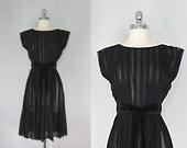 Vintage 1950s Dress. Black chiffon and a velvet bow. Cocktail dress.