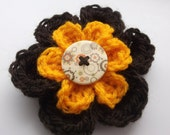 Flower Hair Bobble: orange and brown crocheted flower hair bobble
