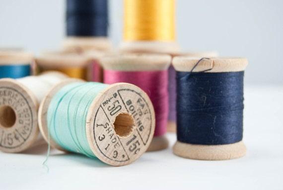 Eighteen Vintage Wooden Spools of Various Colors of Thread