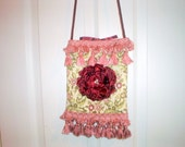 Vintage fabric purse with tassel trim and handmade flower