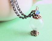 SALE- Miniature Magic Crystal Ball. Necklace. Hollow Glass Globe. Blue. Swarovski Crystal. Wizard. Palm Reader. Gunmetal. Dainty. Whimsical.