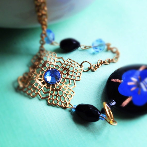 Blue Flower Glass Pendant with Gold Findings. Asymmetrical Necklace. Glass Beads. Blue. Black. Whimsical. Floral. Gift