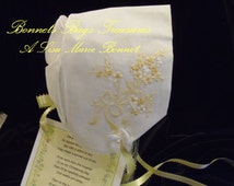 Heirloom Baby Bonnet Embroidered with yellow flowers The sides are adorned with Yellow ribbons and white satin bows