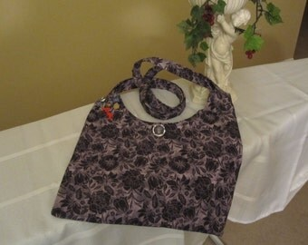 Purple Tote with a curved-style cut is made from cotton with clear-knob button Attached whimsical bracelet
