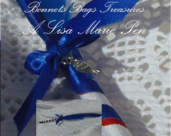 Patriotic Blue Feather pen wrapped with Red White Blue ribbon Accented with Blue bow and silver Angels wing charm