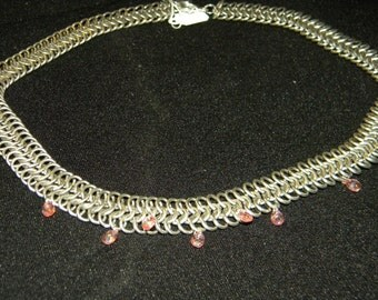 Chainmaile necklace with pink crystals