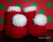 Crocheted Red and White Christmas Booties for Your Newborn