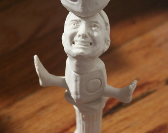 Unglazed White Porcelain Commodity Self Portrait Totem with Milk Jugs and Two Left Feet