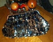 Black Satin Purse Clutch with Metallic Disc and funky silver toned closing knobs Metallics Rule the Season