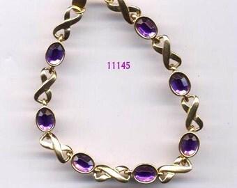 X and O Bracelet with Amethyst Stones AVON    Item No: 11145