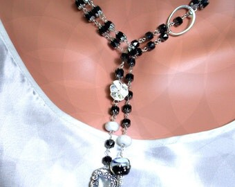 Black Glass faceted Black W Silver on the ends, Antique Luggage Tag Ending and Lampwork all in One