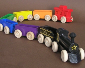 Wooden Toy Rainbow Train with black locomotive.