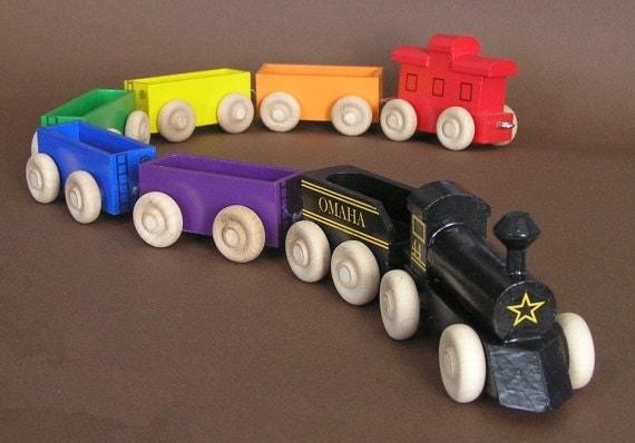 Wooden Toy Rainbow Train with black locomotive.