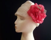 A Little Girl's White Cap with Brim and Pink Flower