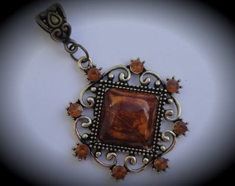 Brown Gold Pendant With Crystals