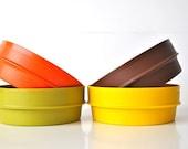 Nesting Tupperware bowls orange yellow brown green
